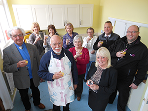 Councillor Christine Potts, front, raises a glass with members of St Aidan's Church to celebrate the upgrading of the Church Hall's kitchen.