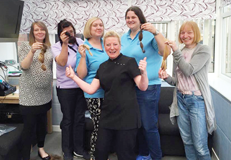 Hairdresser, Julie Dowson Cummings with Ladder Centre staff following their charity haircut in April.