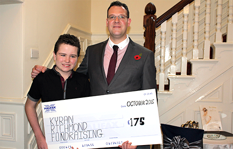 Kyran Richmond accepts a cheque for £175 from Laurie Simpson, manager of the Eden Arms Hotel, who raised the funds on a five-day circular walk in the Peak District.