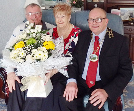 Edward and Sylvia Bell are congratulated on reaching their golden wedding anniversary by Ferryhill's mayor.