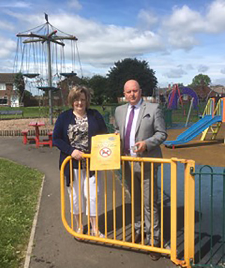 Mayor of Chilton, Cllr Tonya Duprey and  Town Clerk, Paul Gray with a damaged dog control sign. Three other signs have been removed but not recovered.