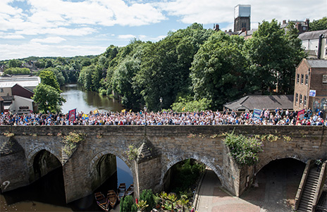 Teaching Assistants cross Elvet Bridge during this year's Durham Miners' Gala. Photo: perrinewtonphotography.com