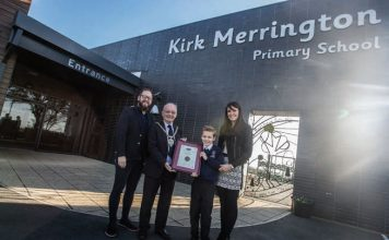 Blake with Cllr Kellett and his parents Victoria Duke and David Stephenson after receiving his award.