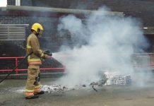 A firefighter from Spennymoor Fire Brigade puts out the 'Great Fire of London'.