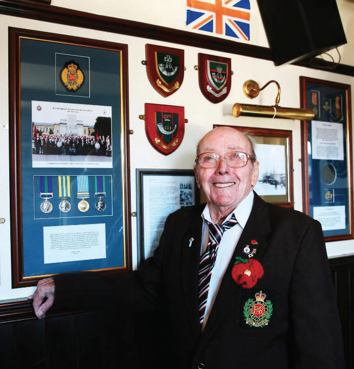 War Veteran, Lenny Hanratty unveils a memorial plaque containing copies of his war medals after the originals were stolen in a burglary at his nursing home.