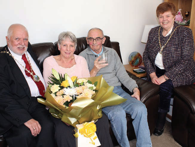 Ferryhill Mayor, Cllr John Lindsay and his Consort, Linda, present Sandra and Les Brown with gifts to commemorate their Golden Wedding anniversary.