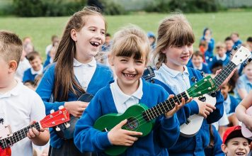 Pupils take part in a ukulele lesson.