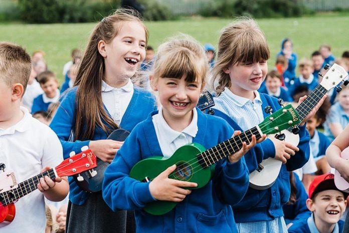 Pupils take part in a ukulele lesson.