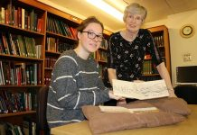 Durham Record Office volunteer Bridget Cox and principal archivist Gill Parkes examine paintings and drawings from DLI soldiers which will be catalogued as part of The DLI: A Whole New Story project.