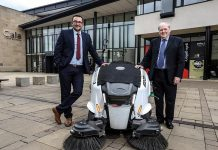 Cllr Carl Marshall, Cabinet member for economic regeneration (left) and Cllr Brian Stephens, Cabinet member for neighbourhoods and local partnerships, with the electric road sweeper.