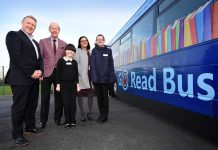 Colin Barnes, Brian Walker, Sara Swales and pupils Alexa and Harry with the new Go Read Bus.