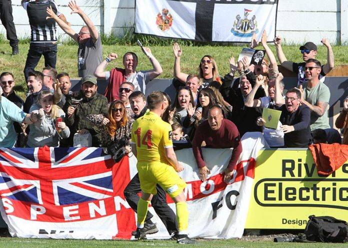 Mark Anderson celebrates with the fans, but Chorley would go on to win the penalty shoot-out. Photo: Andrew Ferguson.
