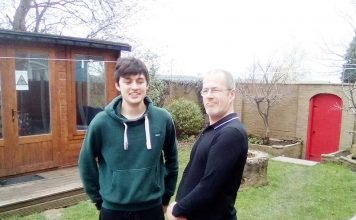 Creative Support care workers Ryan Johnson (left) and Steve Dobson pictured in the garden.