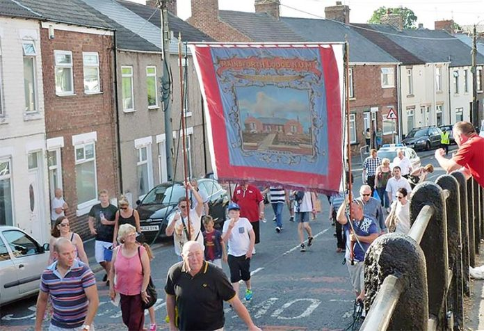The Mainsforth Lodge banner parades through Ferryhill.