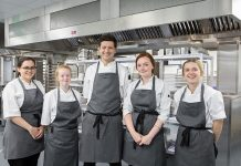 Members of The Auckland Project Catering Team in the Central Kitchen, (L-R) Chef, Katherine Hindes, Commis Chef, Jane Ann Taylor, Culinary Director, Ant Brown, Commis Chef, Lucy Hendron and Commis Chef Emma Rowell.