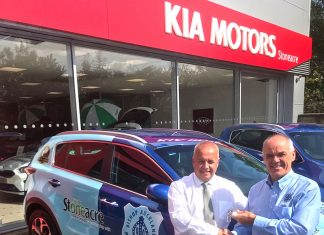 Bishop Auckland chairman, Steve Coulthard (right) accepting keys to the car from Stoneacre Kia's General Sales Manager, Jack McKeag.