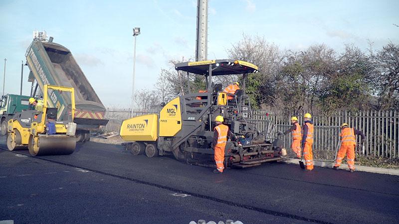 Road resurfacing using the new surfacing mix.