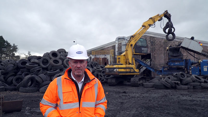Mark Readman, the council's highway services manager, with the waste tyres.