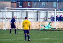 Marske United's Robert Dean saves Matty Roberts' penalty. Photo: Martyn Tweddle.