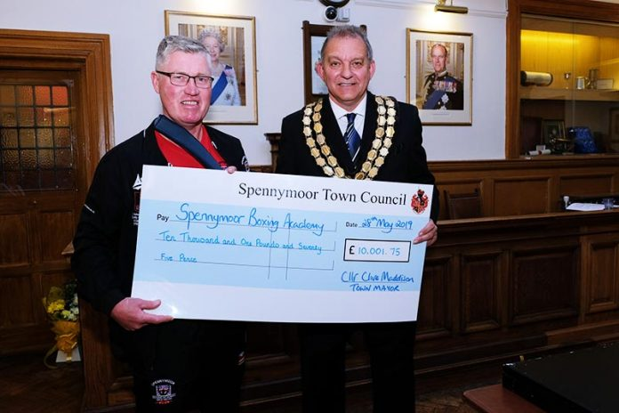 Former Mayor of Spennymoor, Cllr Clive Maddison presents a cheque for £10,001.75 to Robert Ellis of Spennymoor Boxing Club.