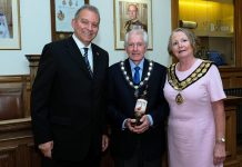 Former mayor, Cllr Clive Maddison hands over the chains of office to new Mayor of Spennymoor, Cllr Elizabeth Wood and her consort, Mr Eric Rix.