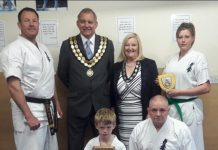 Chief instructor, Adam Walker welcomes Spennymoor Town Mayor and Consort, Cllrs Clive and Liz Maddison who presented awards to Jack Walker (front left), Stevie Bingham and Keeley Nixon.