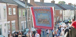 The Mainsforth Lodge banner parades through Ferryhill.