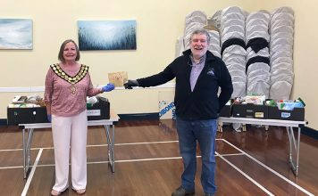 Spennymoor Mayor, Cllr Elizabeth Wood, handing £500 to Maurice Aspey, one of the St Paul's food bank volunteers.