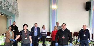 Council staff and members make up care packages at the Town Hall.