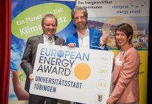 Boris Palmer, Mayor of Tübingen in Germany, centre, collects a European Energy Award in 2018 Credit: Martin Stollberg, Umweltministerium Baden-Württemberg