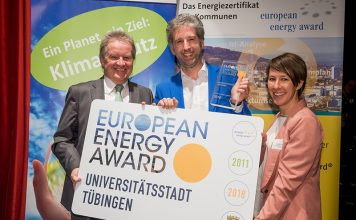 Boris Palmer, Mayor of Tübingen in Germany, centre, collects a European Energy Award in 2018 Credit: Martin Stollberg, Umweltministerium Baden-Württemberg